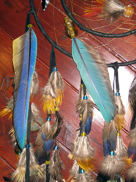 detail of peacock and pheasant feathers on dreamcatcher