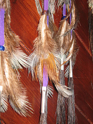 detail of horse hair and pheasant feathers in dreamcatcher