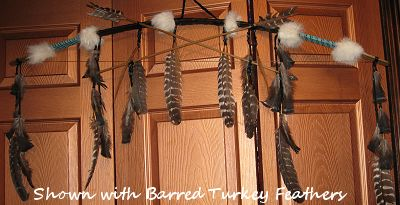 bow with crossed arrows set shown with barred turkey feathers