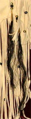 Detail of horse hair bundles on buckskin quiver