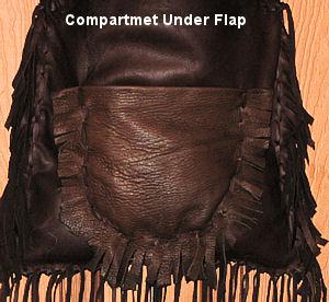 detail of compartment under flap on deerskin bag