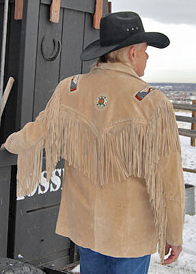 back of black fringed jacket with turquoise eagle beadwork
