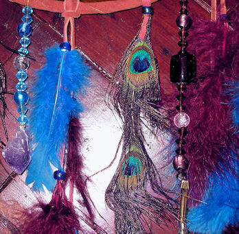 Details of amethyst crystal and peacock feathers dream catcher